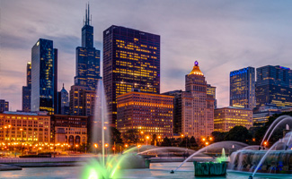 Chicago buildings and a large water fountain at dusk